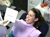 Patient is happy with the final results of her laser teeth whitening
